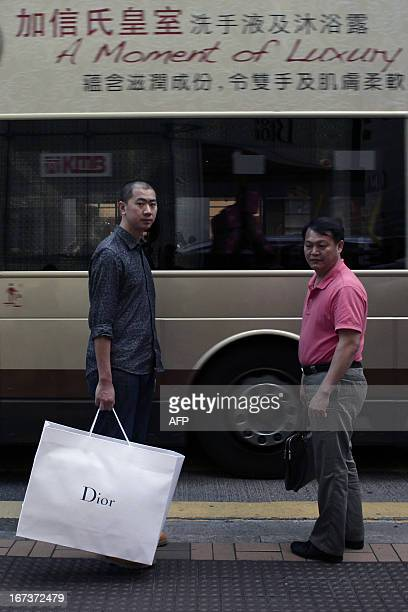 To go with LifestyleHongKongChinaluxuryFOCUS by Beh Lih Yi This picture taken on April 23 2013 shows a Chinese mainland tourist holding a Christian...