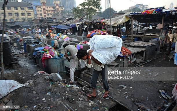 To go with LifestyleIndiaconsumertechnologyFEATURE by Karishma VyasA washermen carries clean clothes at Dhobi Ghat in the Indian city of Mumbai on...