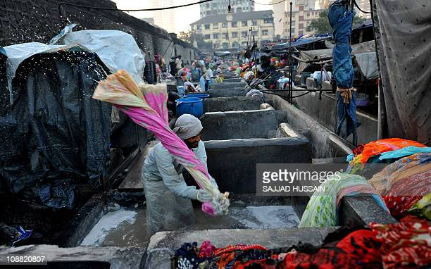 To go with LifestyleIndiaconsumertechnologyFEATURE by Karishma VyasA washermen clean clothes by hand at Dhobi Ghat in the Indian city of Mumbai on...