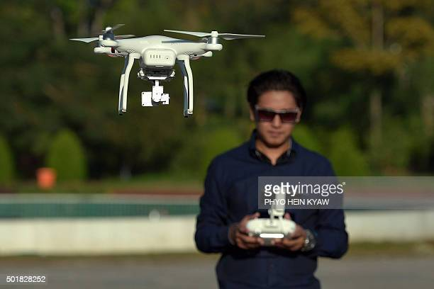 To go with MyanmardronetechnologysciencehobbyFEATURE by Kelly Macnamara This photo taken on November 24 2015 shows a drone enthusiast piloting his...