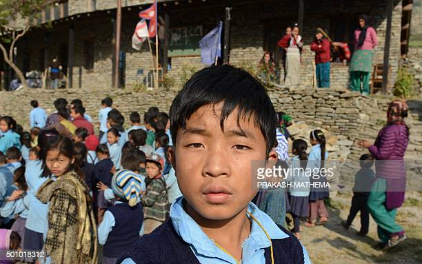 To go with NepalquakewinterFOCUS by Ammu Kannampilly In this photograph taken on December 7 twelveyearold Nepalese school student Dawa Phunchok Lama...