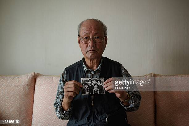 To go with 'NKorea SKorea diplomacy family reunion' ADVANCER by Lim ChangWon In a photo taken on October 16 2015 Park YunDong holds a photo of his...