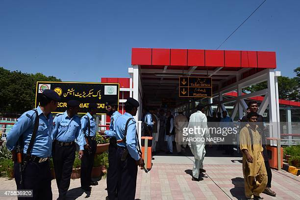 To go with PAKISTANTRANSPORTBUSPOLITICS by Masroor GILANI In this picture taken on June 1 Pakistani police stand at the entrance of the Metrobus...