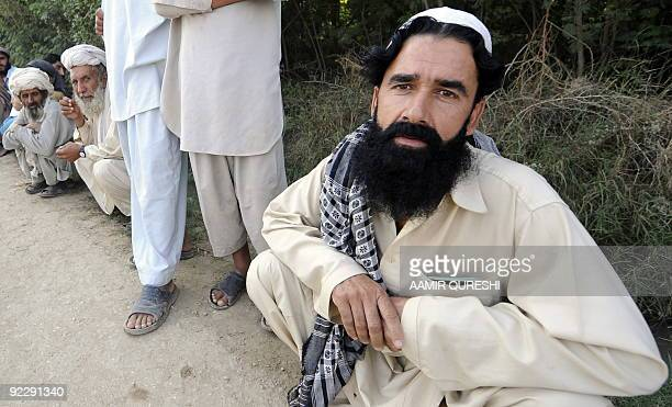 To go with Pakistanunrestnorthwestmusic by Lehaz Ali This picture taken on October 20 shows Pakistani musician Mohammad Akbar sitting in a queue to...