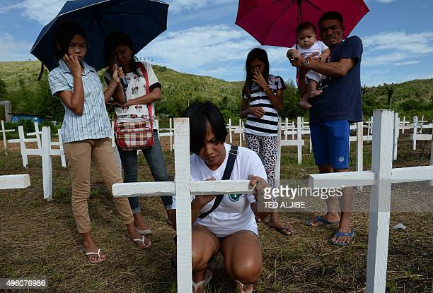 To go with 'PHILIPPINESTYPHOONPOVERTY' by Imelda MAGBUTAY This photo taken on November 1 2015 shows typhoon Haiyan survivor Juvelyn Luana writing the...