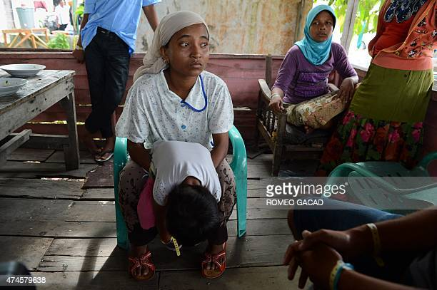 To go with SEAsia migrants Indonesia children by Olivia Rondonuwu In this picture taken on May 23 Mimi a Rohingya mother from Myanmar and her...