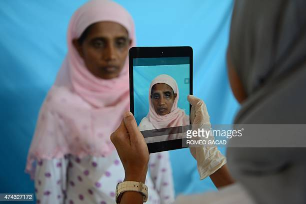 To go with SEAsia migrants Indonesia Focus by Olivia Rondonuwu In this photograph taken on May 19 Rohingya woman from Myanmar Rehana Begum is...