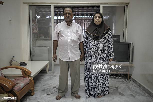 To go with SEAsiamigrantsmigrationMalaysiaRohingyaFOCUS by Satish Cheney This photo taken on May 21 2015 shows Nur Husen Ahmad and his wife Shamsidar...