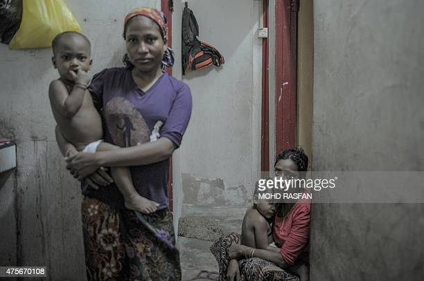 To go with SEAsiamigrantsmigrationMalaysiaRohingyaFOCUS by Satish Cheney This photo taken on May 22 2015 shows ethnic Rohingya refugee women from...