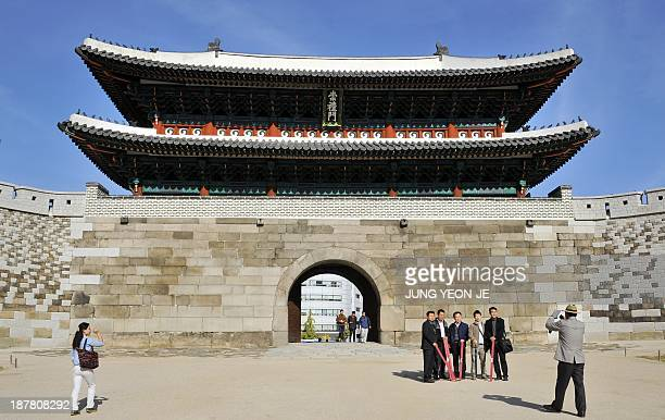 To go with SKoreaculturehistorygateFOCUS by Park ChanKyong This picture taken on November 8 2013 shows the restored Namdaemun Gate in Seoul South...