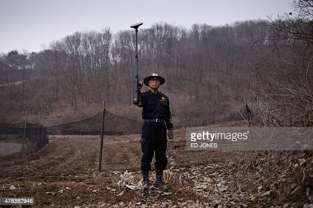 To go with SKOREAMILITARYLANDMINE by Jung HaWon In a photo taken on March 17 Kim KiHo head of the Korea Research Institute for Mine Clearance poses...