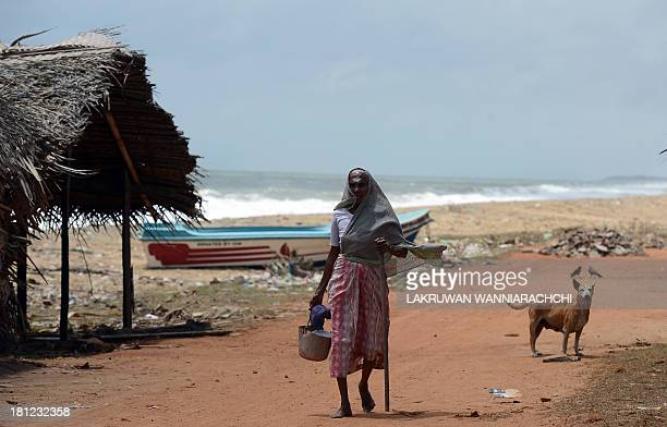 To go with SriLankaAustraliapoliticsimmigrationrefugeeFOCUS by Amal Jayasinghe In this photograph taken on August 23 a Tamil woman walks in the north...