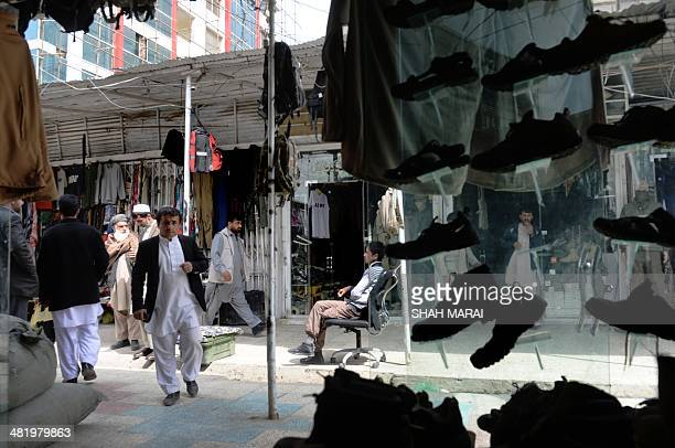 To go with story 'Afghanistanunrestelectioneconomy' by Emal HAIDARY Afghan residents look for US products at a shop in Bush Market in Kabul on April...