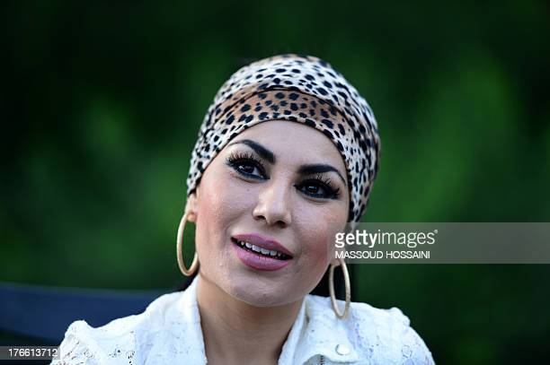 To go with story 'Afghanistanunrestwomenculture' by Edouard Guihaire In this photograph taken on July 12 Afghan female singer Aryana Sayeed conducts...