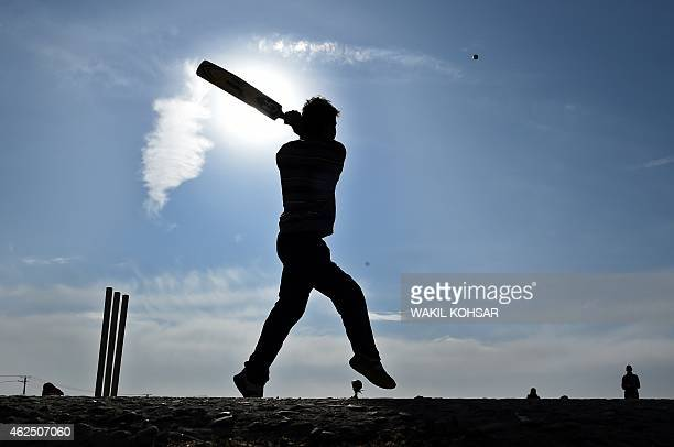 To go with story 'CricketWC2015AFG' by Mushtaq MOJADDIDI In this photograph taken on December 12 an Afghan cricket player bats during a friendly game...