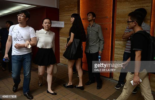 HongKongChinapoliticsdemocracyFOCUS by Annabel SYMINGTON Ruby TAM Mainland Chinese tourists watch as prodemocracy protesters gather during a...