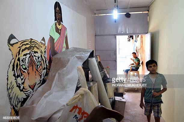 IndiaartsocietyhealthFOCUS by Rachel O'Brien A neighbourhood youth walks through the 'Colour Box' one of the venues of the Dharavi biennale starting...