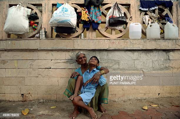 To go with story 'Indiadisabledrightspoverty' by Rachel O'Brien In this photograph taken on May 20 2014 nine year old Indian boy Lakhan Kale sits...