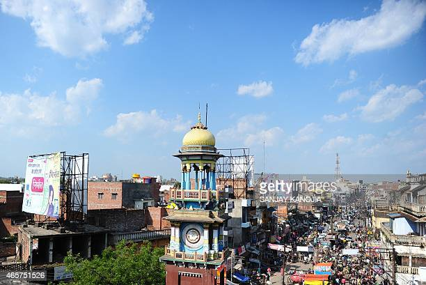 To go with story 'Indiaeconomyurbanisation' by Trudy HARRIS In this photograph taken on March 4 2015 the famous clock tower is located in the middle...