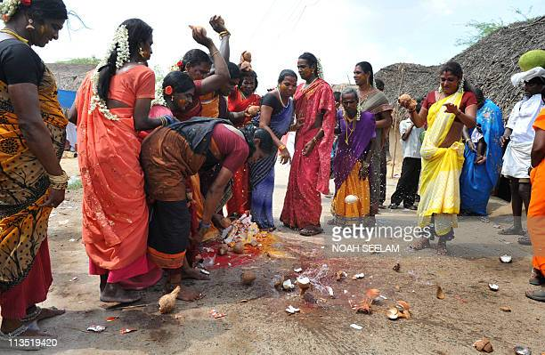 To go with story 'Indiareligiongayfestivalgender' by Ammu KannampillyIndian transgenders break coconuts to welcome the ritual procession pulling the...