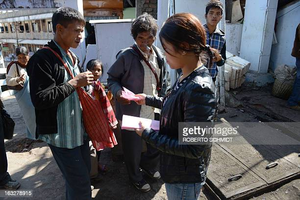 To go with story 'Indiawomenrightstradition' by Ammu Kannampilly In this photograph taken on February 1 men take leaflets from Carelynda Lihgdon as...