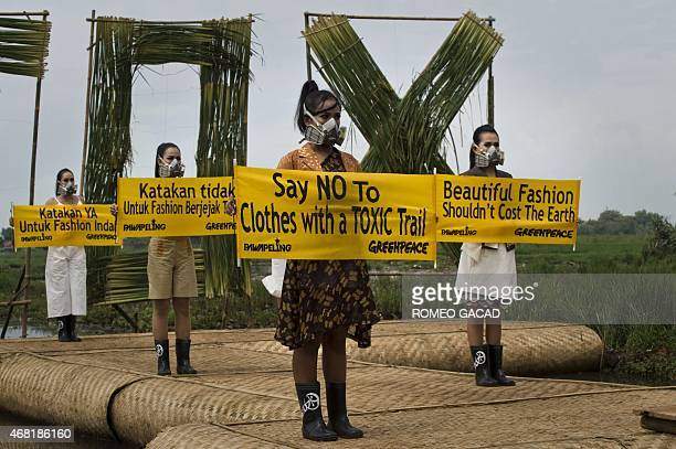 Indonesia environment water pollution fashion In this photograph taken on March 22 2015 Indonesian models with gas masks wearing dresses by Lenny...