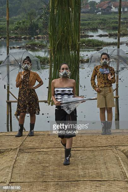 To go with story Indonesia environment water pollution fashion In this photograph taken on March 22 2015 Indonesian models with gas masks wear...