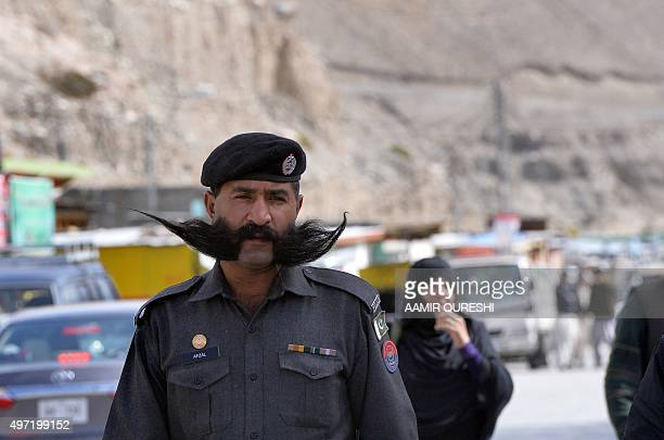 To go with story 'PakistanChinaeconomytransport FEATURE' by Guillaume LAVALLÉE In this photograph taken on September 29 a Pakistani policeman walks...