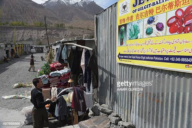 To go with story 'Pakistan-China-economy-transport, FEATURE' by Guillaume LAVALLÉE In this photograph taken on September 29 a local customer browses...