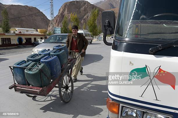 To go with story 'Pakistan-China-economy-transport, FEATURE' by Guillaume LAVALLÉE In this photograph taken on September 29 a Pakistani labourer...
