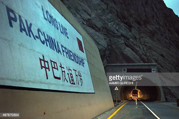 To go with story 'Pakistan-China-economy-transport, FEATURE' by Guillaume LAVALLÉE In this photograph taken on September 29 a loaded truck travels...