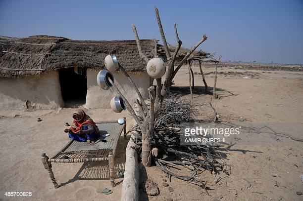 To go with story 'Pakistan-Energy-Solar-Environment', FOCUS by Khurram SHAHZAD In this photograph taken on February 17, 2014 a Pakistani villager...