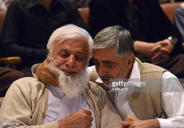 To go with story 'PakistanFranceunrestattacks' In this photograph taken on November 16 a Pakistani man comforts the father of a student who was...
