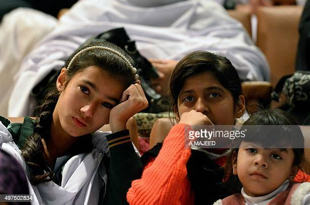 To go with story 'PakistanFranceunrestattacks' In this photograph taken on November 16 Pakistani girls whose relatives were amongst those killed...