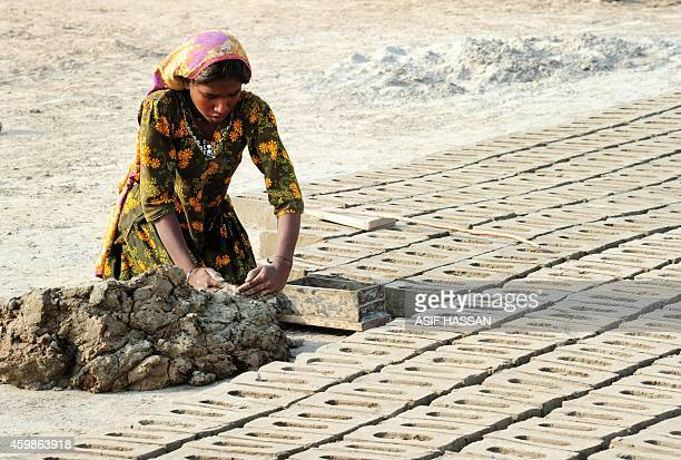 To go with story 'PakistanLabourRightsSlavery' by Guillaume Lavallee In this photograph taken on November 10 2014 Pakistani labourer Jheny makes...