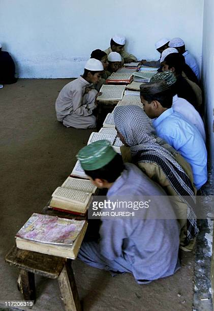 "To go with story ""USattacksBinLadenPakistanchildrenFOCUS"" by Khurram Shahzad Pakistani students recite the Koran at a Islamic madrassa near the final..."