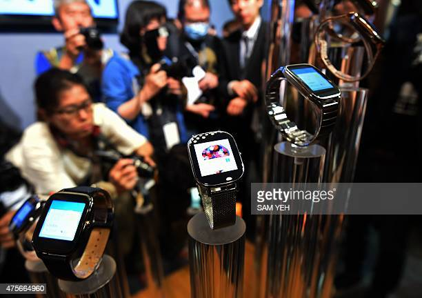 To go with Taiwan-lifestyle-technology-wearables-Computex,FOCUS by Laura Mannering This picture taken on June 2, 2015 journalists taking photos of...