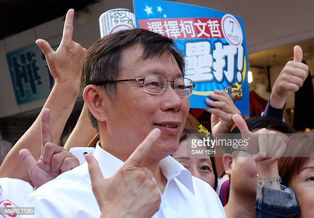 To go with TaiwanpoliticsvotemayorFOCUS by Amber Wang In this picture taken on November 25 Ko Wenje an independent Taipei mayor candidate gestures...