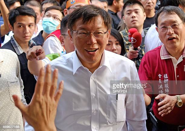 To go with TaiwanpoliticsvotemayorFOCUS by Amber Wang In this picture taken on November 25 Ko Wenje an independent Taipei mayor candidate is greeted...