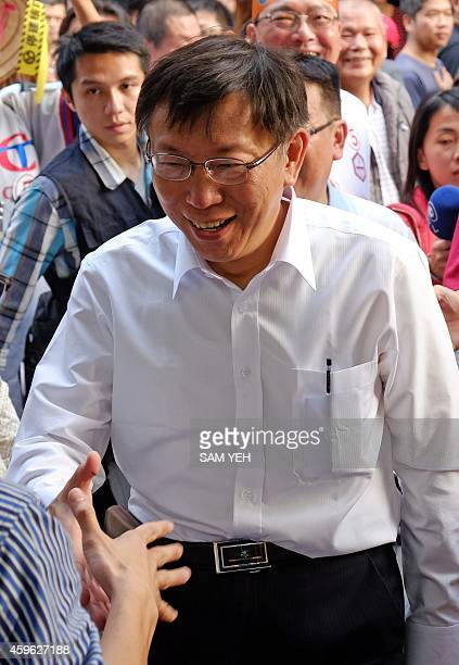 To go with TaiwanpoliticsvotemayorFOCUS by Amber Wang In this picture taken on November 25 Ko Wenje an independent Taipei mayor candidate shakes...