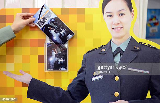 To go with TaiwansocialemploymentwomenFEATURE by Amber WANG In this picture taken on March 20a female sargent picks up the advertisement at the...