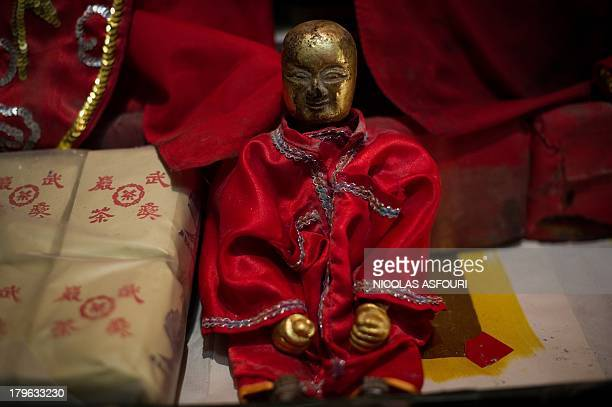 To go with the story Thailand-lifestyle-theatre-opera,FEATURE by Apilaporn VECHAKIJ A doll representing a Chinese God sits on a small shrine...
