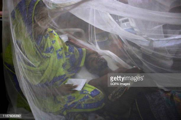 To help fight spread of Dengue fever mosquito nets have been put up in a ward at the city's Shaheed Suhrawardy Medical Hospital Cases of Dengue...