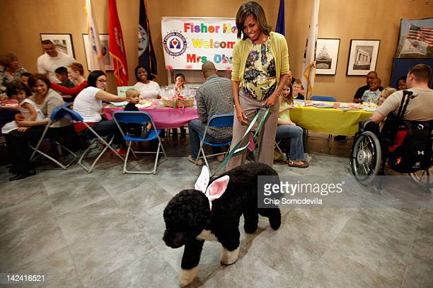 To kick off the Month of the Military Child first lady Michelle Obama and her dog Bo participate in a preEaster celebration with military families...