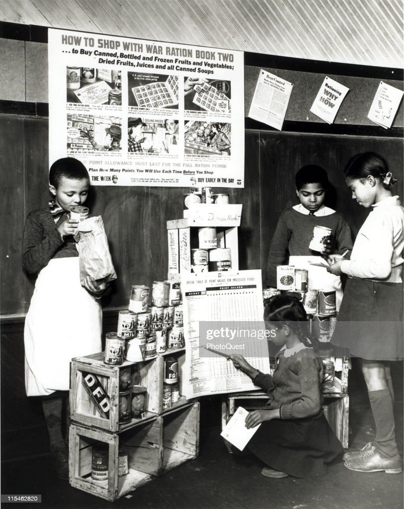 To learn how to shop with point stamps, these youngsters in a Fairfax County, Virginia grade school have set up a play store, complete with point value table and informational material on point rationing, 1943.