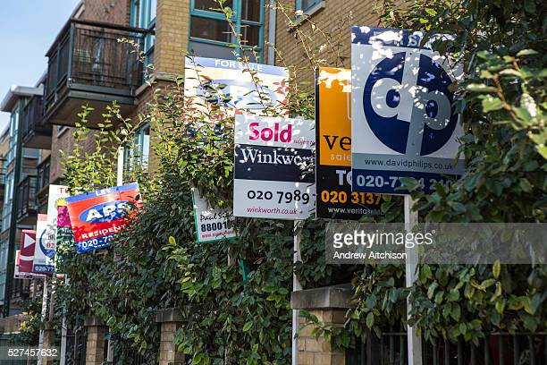 To Let and For Sale Signs outside a block of flats in Hackney London UK