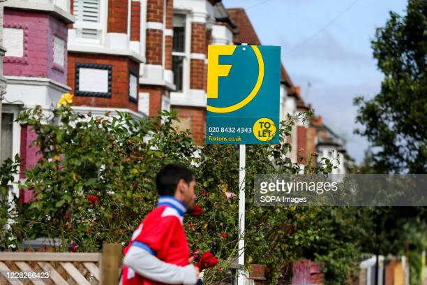 To Let' estate agents' board sign erected outside a property in London.