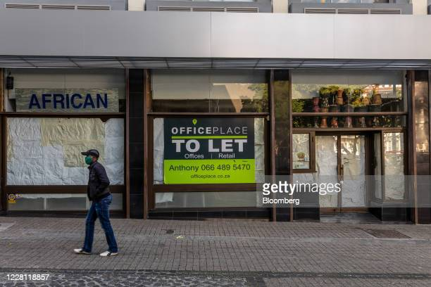 To Let' sign sits in the window of an empty retail unit in Cape Town, South Africa, on Wednesday, Aug. 19, 2020. The country, which in late March...