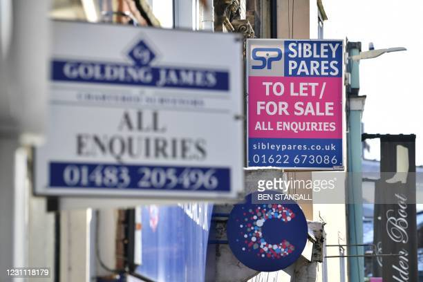 To Let signs are seen on shop units on the high street in Maidstone, southeast England, on February 12, 2021 as life continues in Britain's third...