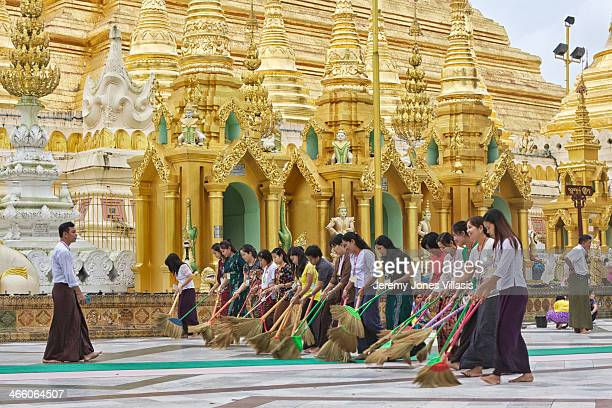 CONTENT] To make merit a group of women volunteers nicknamed The Wednesday Group by locals help keep the grounds clean at Shwedagon Pagoda in Yangon...